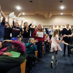 Hannah Bradshaw is greeted by the audience as she returns to her seat after asking a question of Rep. Jason Chaffetz during a town hall meeting in Cottonwood Heights on Thursday, Feb. 9, 2017.
