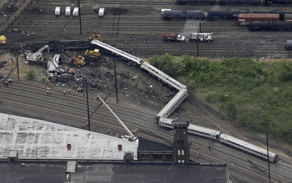 <small>Emergency personnel work at the scene of a deadly train derailment, Wednesday, May 13, 2015, in Philadelphia. | Patrick Semansky/AP</small>