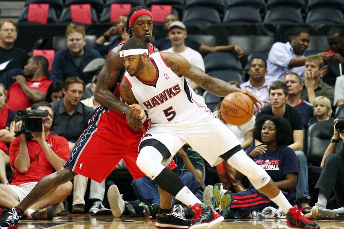 Mar 23, 2012; Atlanta, GA ,USA; New Jersey Nets forward Gerald Wallace (45) posts up against Atlanta Hawks forward Josh Smith (5) at Philips Arena. Mandatory Credit: Marvin Gentry-US PRESSWIRE