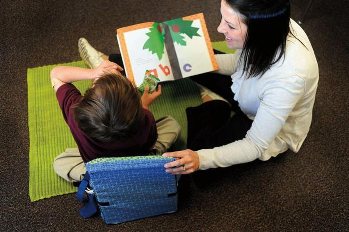 Kimberly Bertha, a special education teacher in Denver works with a student in 2010.