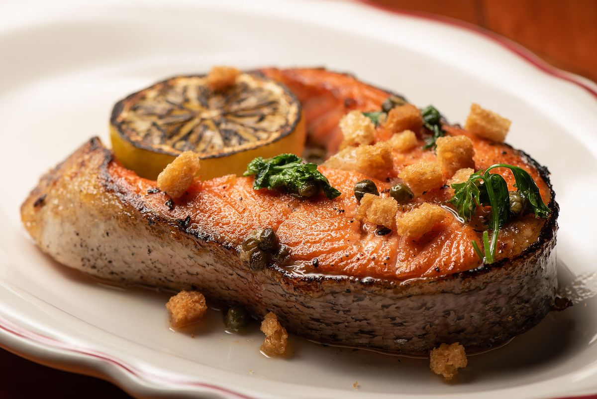 An ocean trout steak with charred lemon.