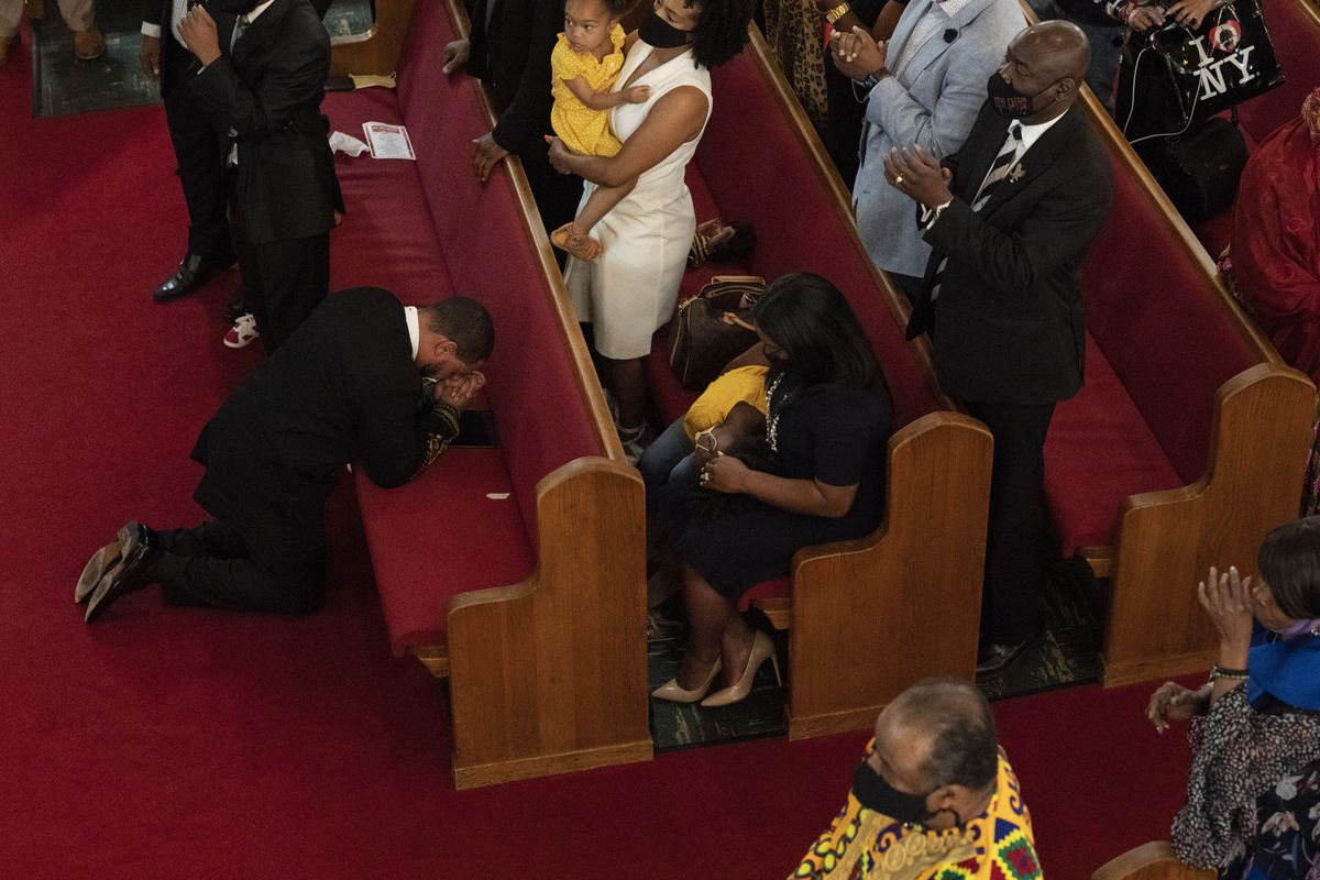 Rev. John R. Faison, Sr. kneels in prayer after preaching at a joint service for the centennial of the Tulsa Race Massacre at First Baptist Church of North Tulsa, Sunday, May 30, 2021, in Tulsa, Okla.