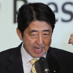 Former Prime Minister Shinzo Abe clenches his fist after winning the party leader election of Japan's Liberal Democratic Party in Tokyo, Wednesday, Sept. 26, 2012. Abe, known as a hawk and nationalist, won the election Wednesday to become president of the main opposition Liberal Democratic Party.
