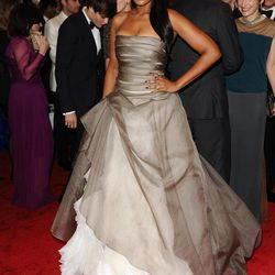 FILE - In this May 2, 2011 file photo, Jennifer Hudson arrives at the Metropolitan Museum of Art Costume Institute gala in New York. More accustomed to walking a red carpet in Vera Wang ballgowns, performing at the Grammy Awards or autographing her new book about weight-loss, the Oscar-winning actress and singer's next public appearance won't be glamorous. The starlet will be under a whole different spotlight in April 2012 in Chicago when she is expected to attend the triple murder trial of the man accused of killing her mother, brother and nephew.