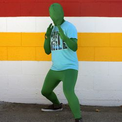 Shortly after this photo was taken, the Green Man's hoodie zipper broke. We hope he survived the heat.