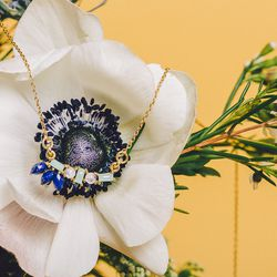 """Katie Diamond 'Laney' necklace, <a href=""""http://katiediamondjewelry.com/collections/necklaces/products/laney-neckalce"""">$200</a>; Stems Brooklyn 'Sweet Something' arrangement, <a href=""""http://stemsbrooklyn.com/bouquets/"""">$50</a>"""