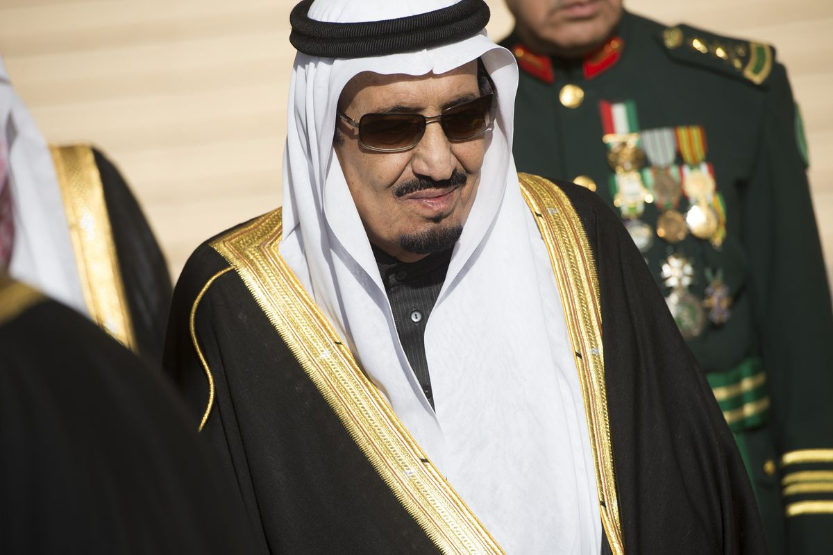 King Salman of Saudi Arabia stands during the arrival of US President Barack Obama and First Lady Michelle Obama at King Khalid International Airport in Riyadh on January 27, 2015.