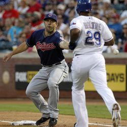 Cleveland Indians third baseman Russ Canzler is unable to handle the throw from third as Texas Rangers' Adrian Beltre (29) reaches first safely in the second inning of a baseball game Tuesday, Sept. 11, 2012, in Arlington, Texas. Beltre advanced to second on the play.