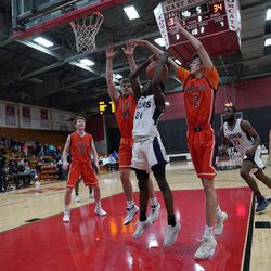Lincoln Park's Ismail Habib (24) manages to make a basket over Naperville North's Netzah Aldana (2) and Riley Thompson, Saturday 02-02-19. Worsom Robinson/For the Sun-Times.