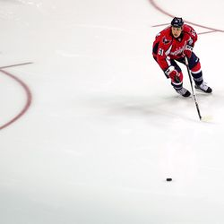 Olesky Skates Towards Puck