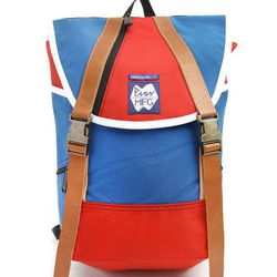 """Steven V. Torres, MRKT: """"This limited edition backpack is compact enough to travel and offers great compartments inside. The French colors make it a great look for spring/summer.<br> Pictured: Commune de Paris x Peters Mountain Work backpack, <a href=""""ht"""