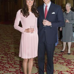 Pretty in a pink Emilia Wickstead dress for a pre-lunch reception on May 18th, 2012.