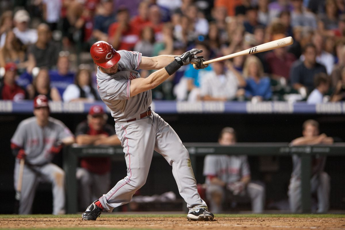 DENVER, CO: Ryan Ludwick #48 of the Cincinnati Reds hits a home run in the eighth inning of a game against the Colorado Rockies at Coors Field in Denver, Colorado. The Reds defeated the Rockies 9-7. (Photo by Dustin Bradford/Getty Images)