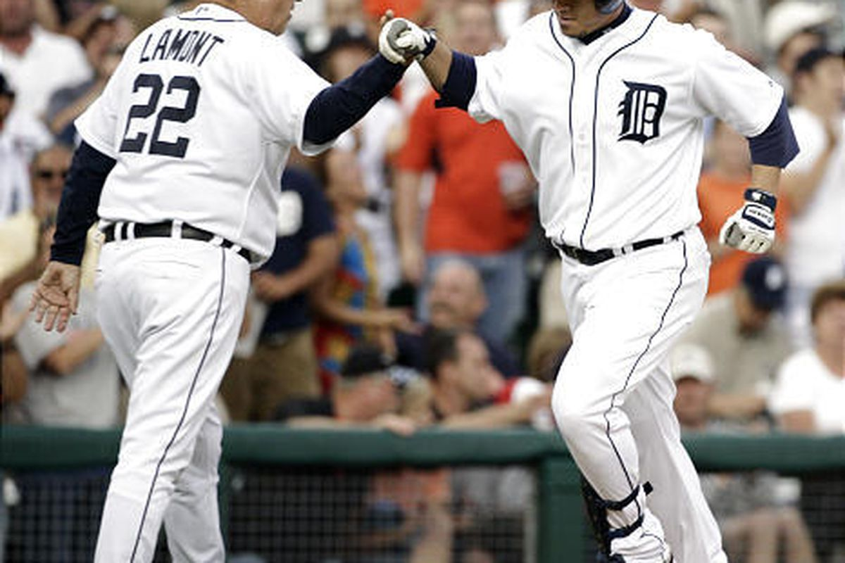 Detroit Tigers' Magglio Ordonez, right, is congratulated by third base coach Gene Lamont after hitting a solo home run against the Baltimore Orioles.