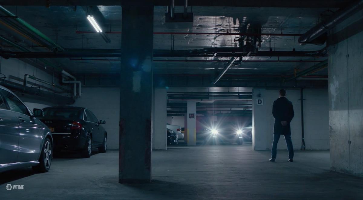 A man standing in a parking garage