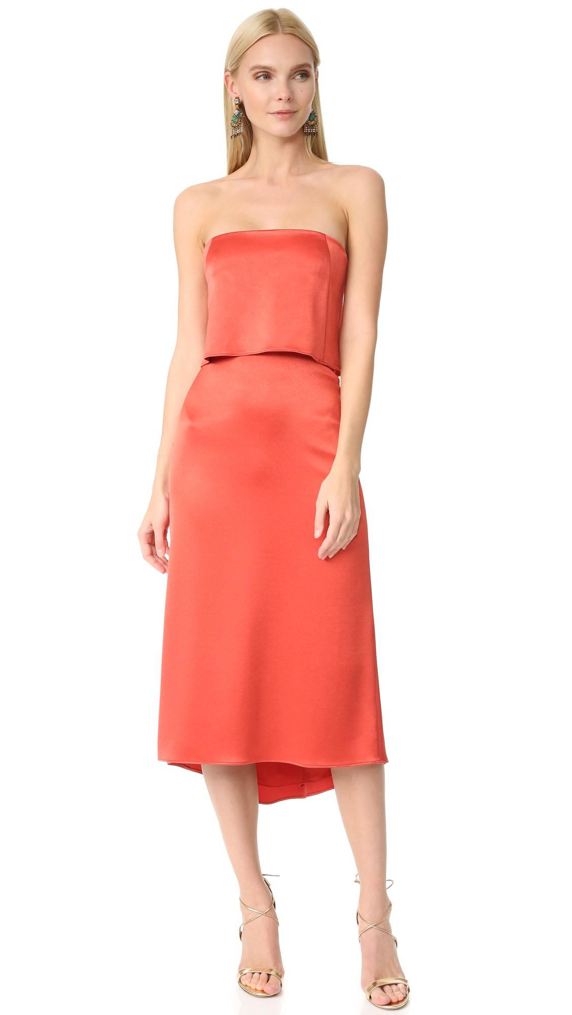 A strapless orange satin dress