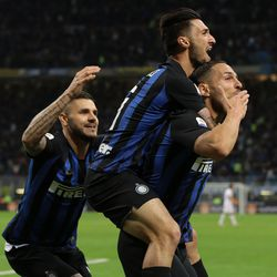 Danilo D'Ambrosio (R) of FC Internazionale celebrates his goal with his team-mates Mauro Emanuel Icardi and Matteo Politano (C) during the Serie A match between FC Internazionale and ACF Fiorentina at Stadio Giuseppe Meazza on September 25, 2018 in Milan, Italy.