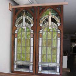 Beautiful stained glass windows hang just behind the host stand