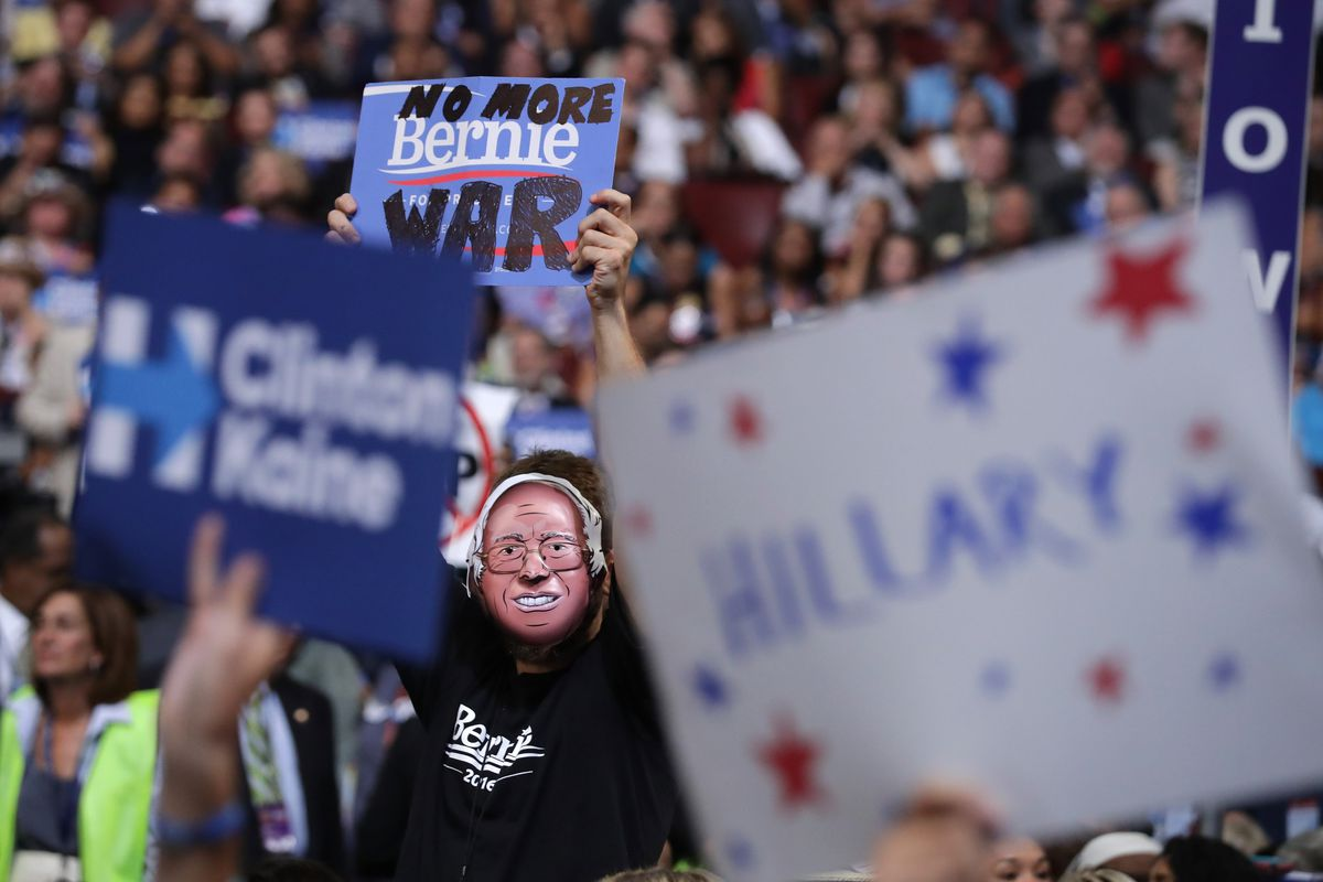 A delegate wearing a Bernie Sanders mask on the third day of the Democratic convention.