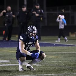 Corner Canyon's Jett Meine pauses after their losss to Lone Peak that ended a 48-game winning streak at Corner Canyon High School in Draper on Thursday, Oct. 7, 2021.