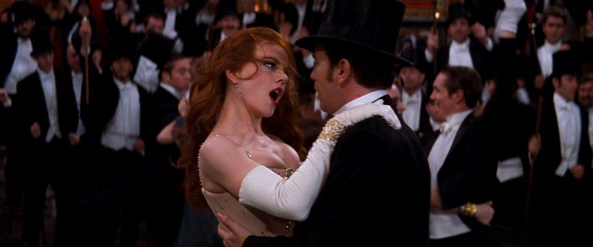 Nicole Kidman, hair askew, pulls Ewan McGregor in close in a dance in Moulin Rouge
