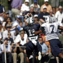 Fans are treated to a successful play by BYU's 11 Ross Apo before #7 Preston Hadley can tackle him on Friday, August 12, 2011.