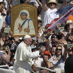 Pope Francis passes in front a portrait of Mother Teresa as he is driven through the crowd at the end of a canonization ceremony in St. Peter's Square at the Vatican on Sept. 4, 2016, where Francis declared Mother Teresa a saint.