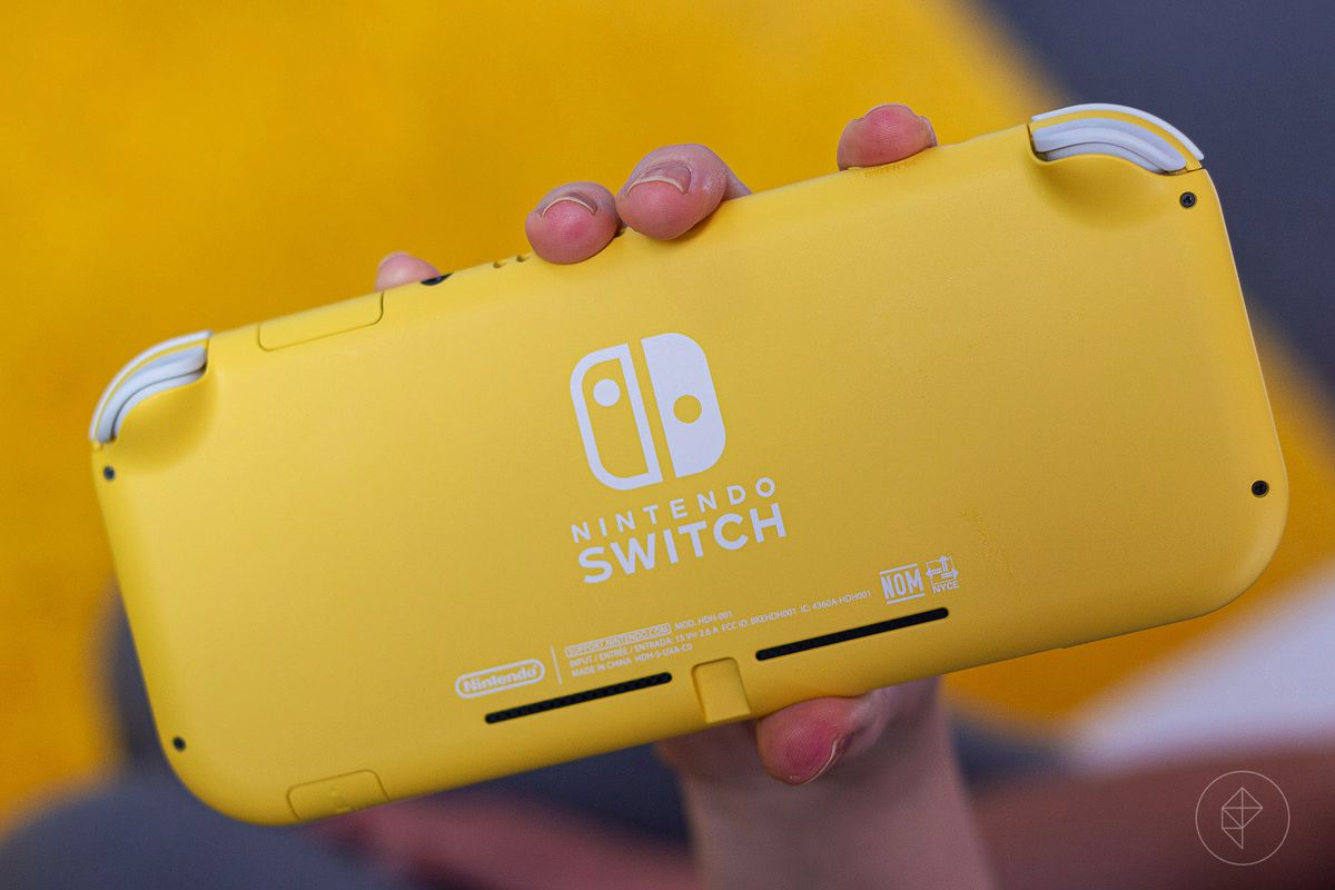the back of the Switch Lite held up by a right hand