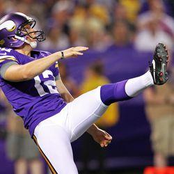 Aug 9, 2013; Minneapolis, MN, USA; Minnesota Vikings punter Jeff Locke (12) punts during the fourth quarter against the Houston Texans at the Metrodome.