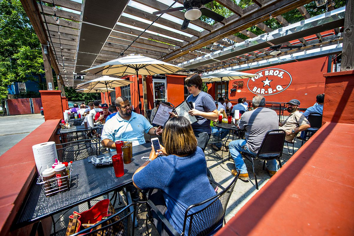 Enjoying lunchtime on the patio at Fox Bros. Bar-B-Q.