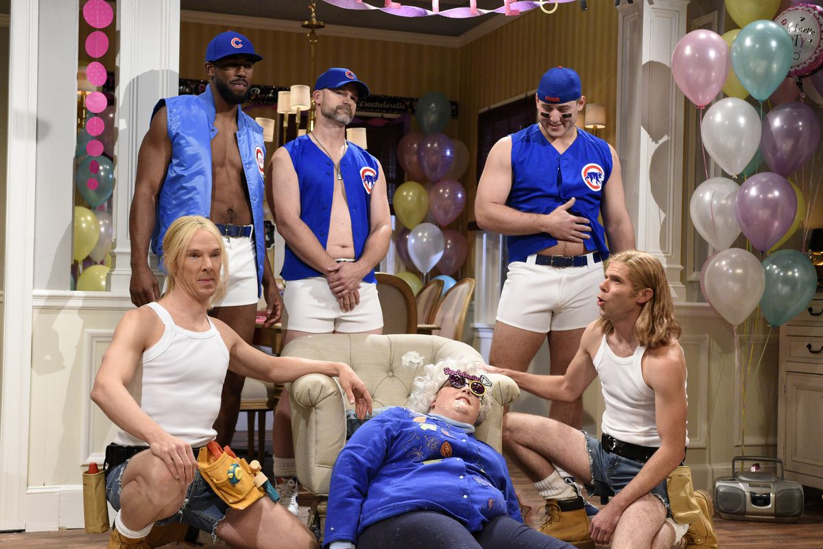 """A troupe of dancers (host Benedict Cumberbatch (from left), Dexter Fowler, David Ross, Anthony Rizzo and Mikey Day) entertains a bachelorette they don't know is dead (Aidy Bryant) during the Nov. 5, 2016, episode of """"Saturday Night Live."""" 