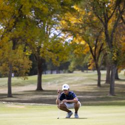 Corner Canyon's Alex Edwards checks his line before putting during the 6A boys state tournament at Davis Park Golf Course in Kaysville on Tuesday, Oct. 5, 2021.