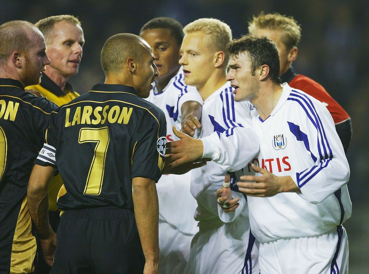 Larsson of Celtic argues with Anderlecht players