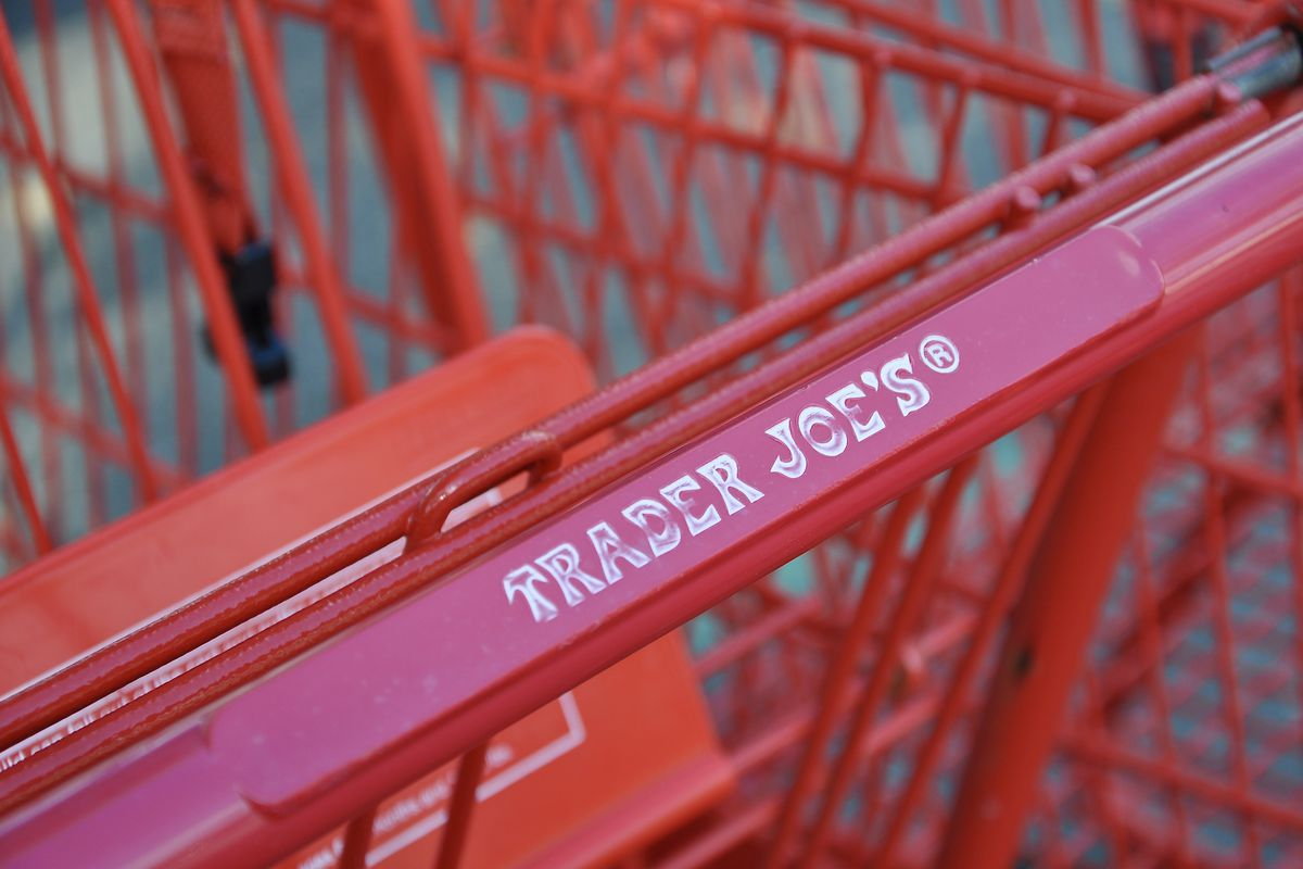 A red Trader Joe's shopping cart with the store's logo