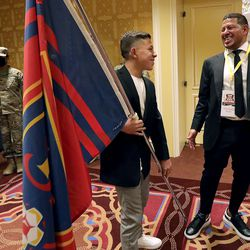 Jett Rimando talks to his father, Real Salt Lake goalkeeper Nick Rimando, before Nick Rimando is honored at the Utah Sports Hall of Fame banquet at the Little America Hotel in Salt Lake City on Monday, Sept. 20, 2021.