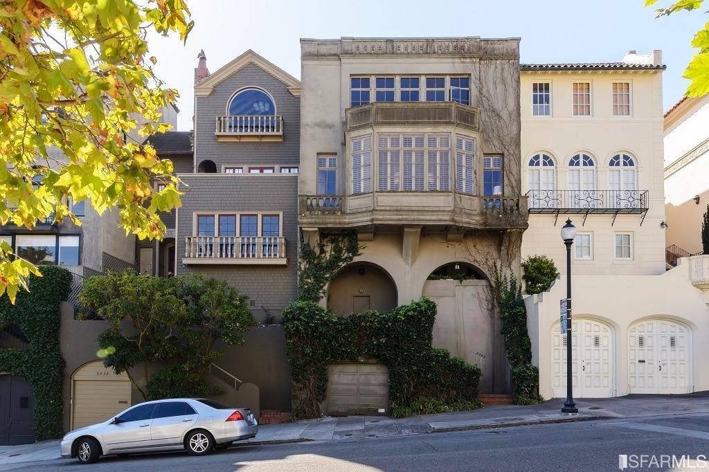 The vine-draped facade of a big house on Jackson Street.