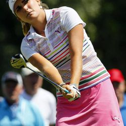 Lexi Thompson watches her ball take flight from the 15th tee during the third round of the Kraft Nabisco Championship golf tournament, Saturday, March 31, 2012, in Rancho Mirage, Calif.