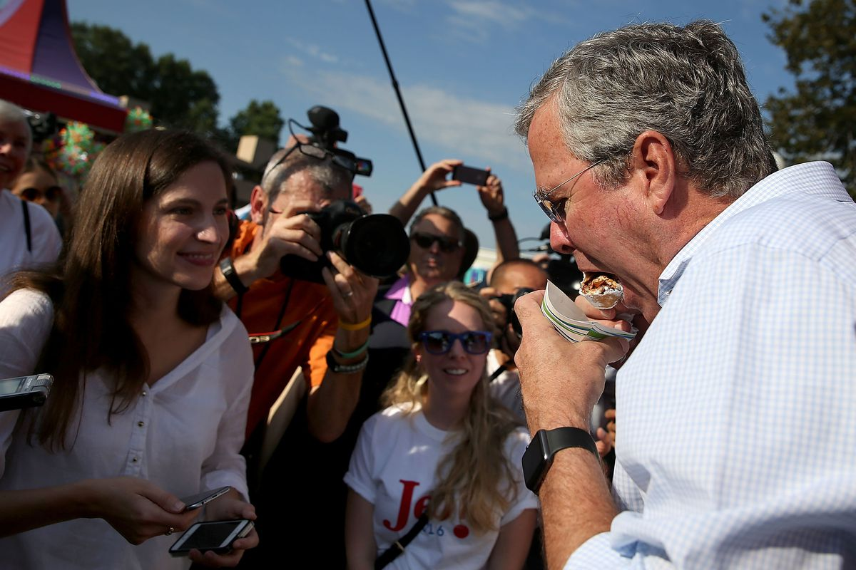 Jeb Bush devouring a fried snickers bar at the Iowa State Fair.