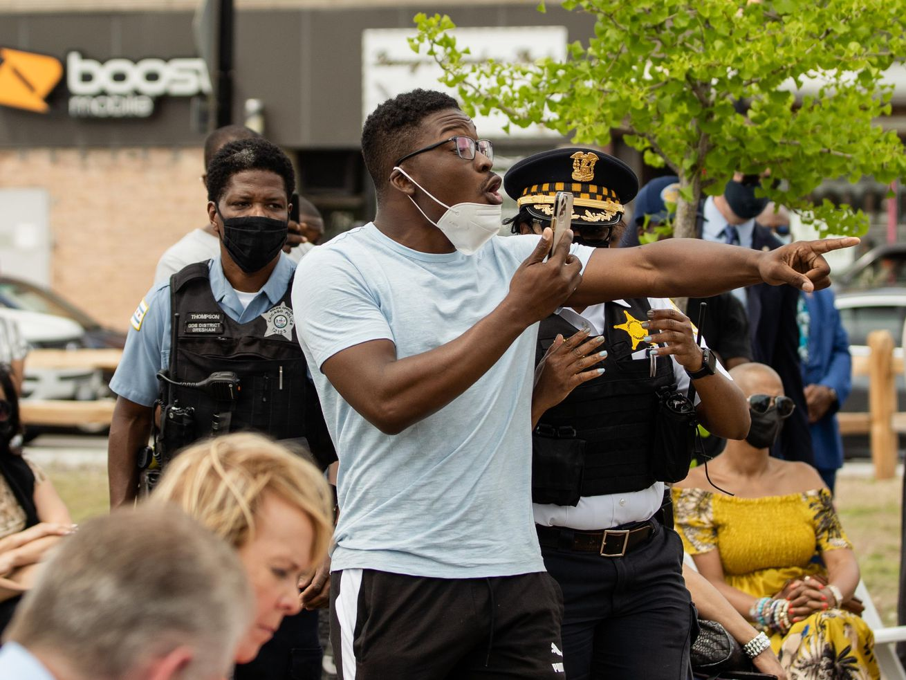 """Activist Ja'Mal Green shouts at Chicago Mayor Lori Lightfoot during a news conference near 79th and Halsted on Friday, May 20, 2021. Green accused Lightfoot of lying after she said she was """"not familiar"""" with a project he's involved with to build a youth center in Auburn Gresham."""