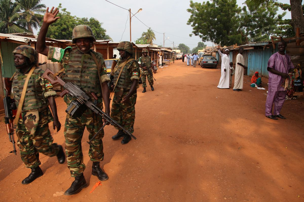 BANGUI, CENTRAL AFRICAN REPUBLIC - JULY 28: Soldiers take security measures during African muslims perform Eid al-Fitr prayer at the Atiq mosque in capital Bangui, Central African Republic on July 28, 2014.