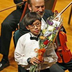 Trenton Chang receives applause after playing Mozart's Piano Concerto N. 17 in G Major during the 50th anniversary Salute to Youth concert Tuesday in Salt Lake City.