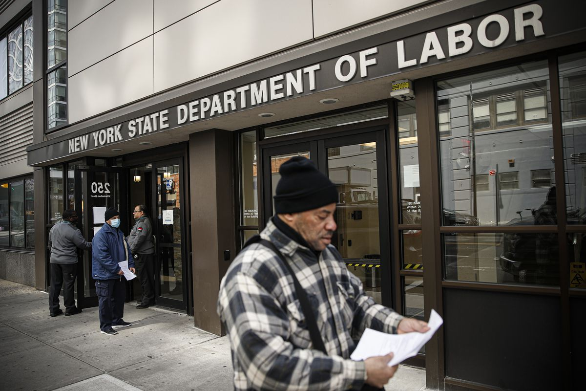 People standing outside the New York State Department of Labor building, March 18, 2020.