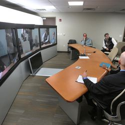 Cory Smith, project manager for Intermountain Healthcare's transformation lab, shows senior French health officials remote conferencing options during a tour of IHC in Murray on Wednesday, Jan. 27, 2016. The French officials were in Utah to learn about how care is delivered here.