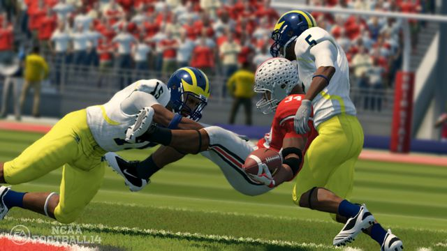 A Michigan football player applies a crunching hit to his Ohio State rival in EA Sports' NCAA Football 14.