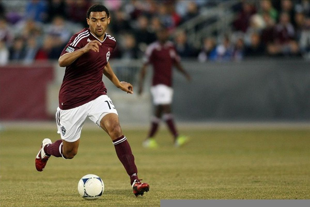 March 10, 2012; Denver, CO, USA; Colorado Rapids forward Andrew Akpan (19) controls the ball during the second half against the Columbus Crew at the Dick's Sporting Goods Park.  Mandatory Credit: Chris Humphreys-US PRESSWIRE