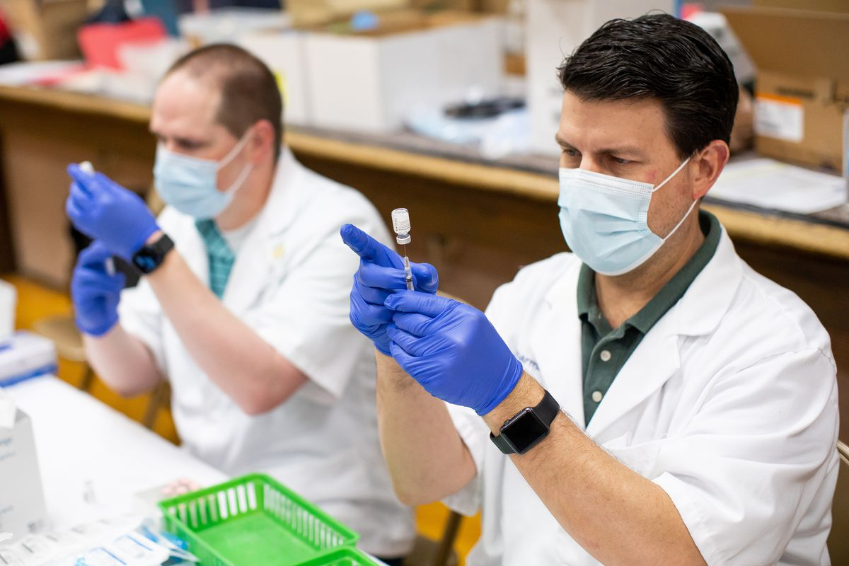 Smith's pharmacists Nate Christensen and Mark Welch prepare doses of the Pfizer-BioNTech COVID-19 vaccine during a vaccination event at a church in Salt Lake City on Saturday, March 20, 2021. The Utah Pacific Islander Health Coalition, Smith's Pharmacy and Salt Lake County teamed up to host the event, with the plan of administering up to 1,170 doses of the Pfizer-BioNTech COVID-19 vaccine to people of Pacific Islander descent.