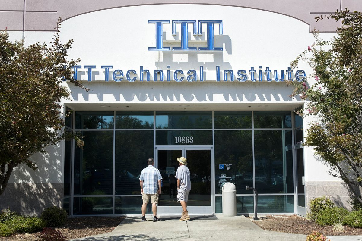 Students find the doors locked to the ITT Technical Institute campus in Rancho Cordova, Calif., in 2016. The U.S. Department of Education announced Thursday it will forgive student debt for more than 100,000 borrowers who attended the now-defunct ITT Technical Institute chain but left before graduating. The school had campuses in Arlington Heights, Oak Brook, Orland Park and Springfield.   AP Photo.