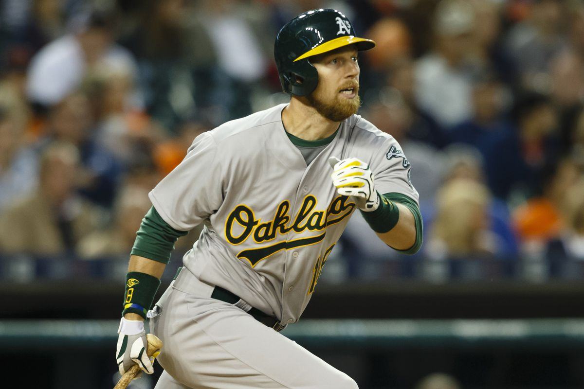 Ben Zobrist reacts as he hits a line drive grand slam to give the A's the lead.