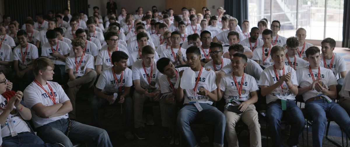 A room full of 16-year-old boys wearing identical T-shirts and lanyards in Boys State.