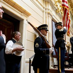 Elder Ronald A. Rasband, left, a member of the Quorum of the Twelve Apostles of The Church of Jesus Christ of Latter-day Saints, left, Garfield County Commissioner Dell Lefevre, members of the Utah National Guard and Senate President Wayne Niederhauser, R-Sandy, stand as the colors are presented by the National Guard in the Senate on the first day of the Legislature at the Capitol in Salt Lake City on Monday, Jan. 25, 2016.